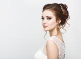 Young pretty caucasian bride in wedding dress