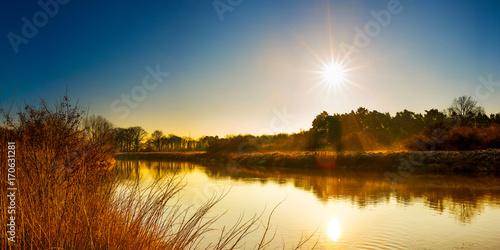 Wall mural Beautiful landscape with river at sunrise