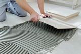 Laying Ceramic Tiles. - 170642034