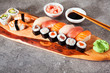 Various kinds of sushi served on a platter with soy sauce, wasab