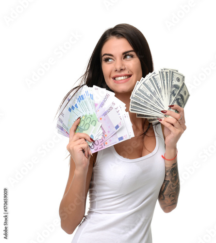 Happy young woman holding up cash money five one fifty hundred euro in one hand and dollars
