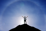 Winner man standing on the top of hill - 170667833