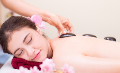Women is getting Hot stone treatment in Spa