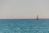 Sunlit Sailboat on a Lake - 170676686