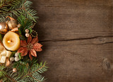 Fir branch with Christmas decorations  and candle on the background of old wooden plank. - 170684089