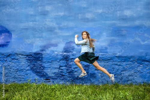 funny jumping young lady on the fairy tale background with crimped face flying and jumping  above the ground Poster