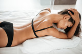 Portrait of a seductive young asian woman in sexy lingerie