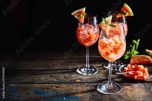 Fresh watermelon cocktails on rustic, dark timber - 170709065