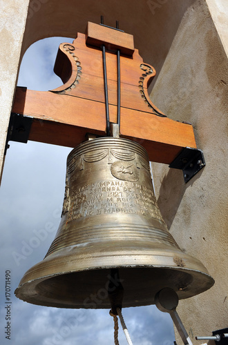 Bronze bell in the bell tower of the church