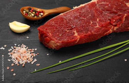 Papiers peints Steakhouse Raw beef steak meat cut and spices on black board