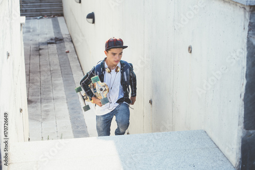 Foto op Canvas Peking Young student man with longboard