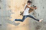 Skater Boy jumping with longboard. - 170726811