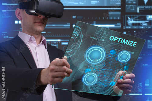 Business, Technology, Internet and network concept. Young businessman working in virtual reality glasses sees the inscription: Optimize