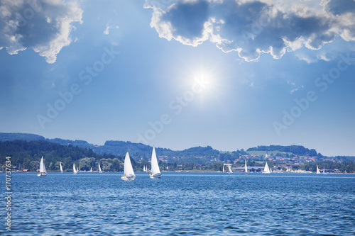Yacht regatta on the lake at sunny day