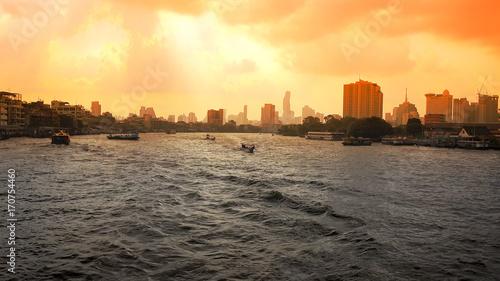 Fotobehang Bangkok Bangkok Skyline and Boats on Chao Phraya River at Sunrise in Thailand