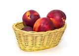Basket full of fresh peaches isolated