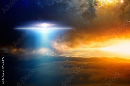 Aluminium UFO Extraterrestrial aliens spaceship in red glowing sky