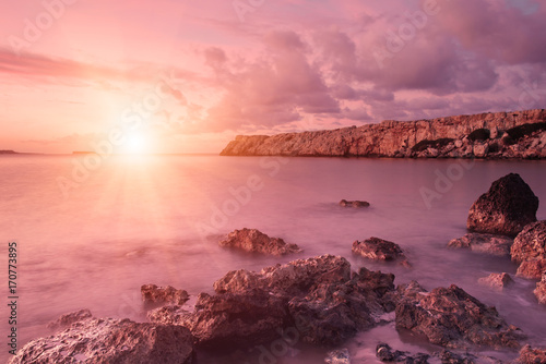 Aluminium Candy roze Beautiful colorful sunrise at the sea with dramatic clouds and sun shining. Beauty world natural outdoors travel background