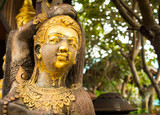 Golden wooden statue in Lamphun - 170779624