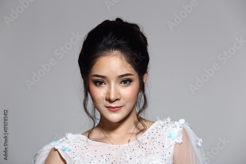 Lovely Asian Beautiful Woman bride in white wedding gown dress with lace, black hair