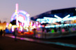 Abstract blur lights of ferris wheel and other attractions at night