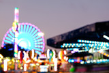 Abstract blur lights of ferris wheel and other attractions at night - 170789864