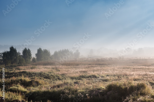 Aluminium Blauwe jeans landscape sunrise in backlight with foggy farm field