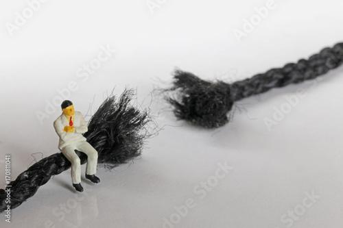 Foto op Plexiglas Retro 切れた紐とビジネスマン