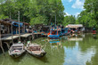 Old wooden boat in the fishing village south-east Asia