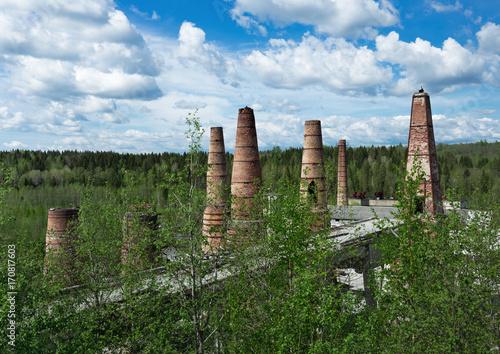 Fotobehang Oude verlaten gebouwen Old brick pipes of factory in Ruskeala, Karelia republic, Russia