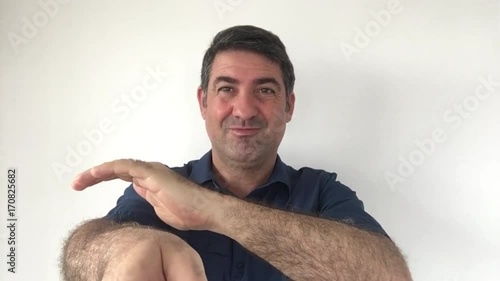 Italian man demonstrate You got it  sign of Italian hand gestures. Body language and facial expression communication concept. Real people. copy space