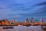 Illuminated London, view over Thames river at night
