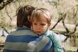 Sad crying son hugging father
