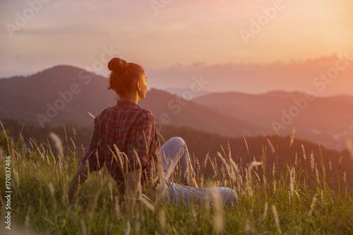 Fotobehang Diepbruine Hipster young girl enjoying sunset on peak mountain. Tourist traveler on background valley landscape view mockup. Toned, instagram vintage filter.