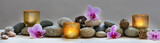 concept of wellbeing with pebbles, orchids and candles, panoramic - 170849214
