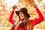 Charming woman walking in autumnal park - 170850048