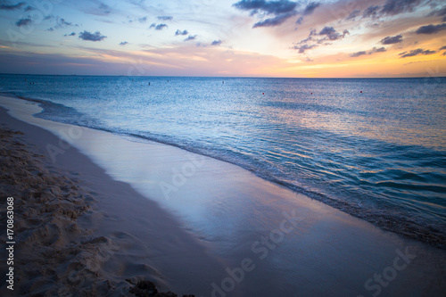 Fotobehang Tropical strand Beautiful beach scene with sea and sunset sky