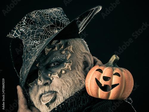 Man with orange pumpkin