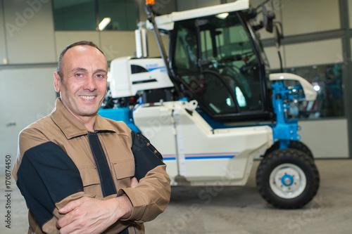 handsome farmer smiling on farmland Poster
