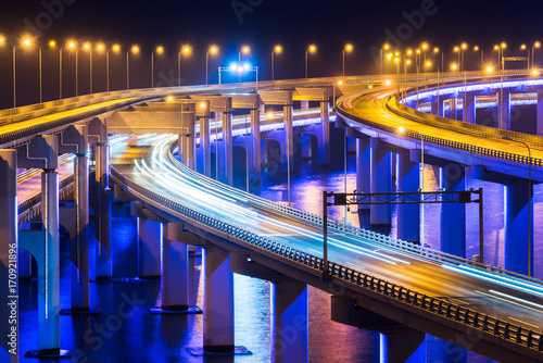 illuminated Xinghai Bay cross-sea bridge of Dalian,China.