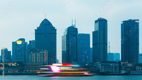 Foto op Canvas Shanghai the bund skyline with blurred cruise boat on huangpu river,shanghai,china.