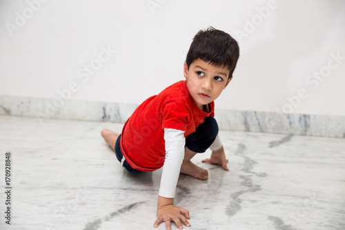 Fotobehang School de yoga A four year old Indian kid doing yoga for fitness