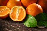 Orange, half of orange, orange lobule on the wooden table. - 170935691