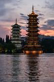 Sun and moon pagodas at sunset in Guilin city, China. - 170936020