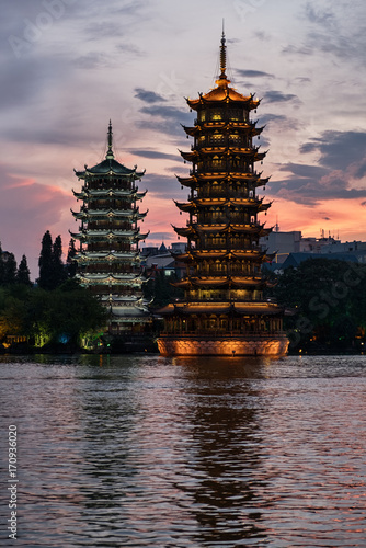 Plexiglas Guilin Sun and moon pagodas at sunset in Guilin city, China.