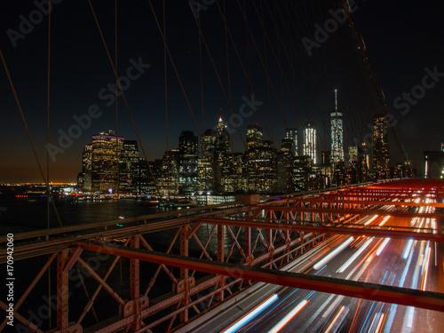 manhattan and brooklyn bridge at night Poster