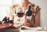 Woman reading a wine label - 170974668