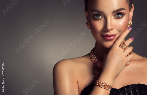 Beautiful girl with jewelry . A set of jewelry for woman ,necklace ,earrings and bracelet. Beauty and accessories.  © Sofia Zhuravetc