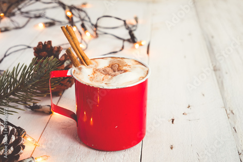 Foto op Plexiglas Chocolade Christmas background - Cup of hot chocolate on wood table with rustic decoration and Christmas lights. vintage color tone style.