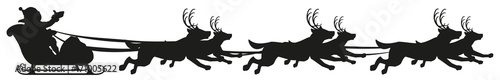 Santa riding dog sled ride. Black silhouette of dogs with horns of deer